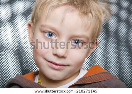 Little boy make face, portrait - stock photo