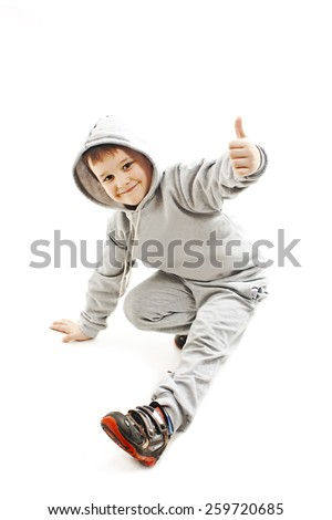 Little cool hip-hop boy in dance showing ok sign. Isolated on white background  - stock photo