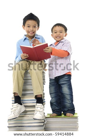 Little cute two boy with many books isolated - stock photo