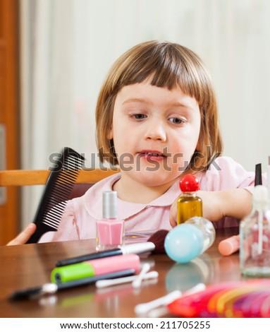 little girl brushing her hair - stock photo