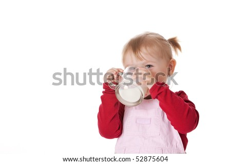 little girl drinks milk - stock photo