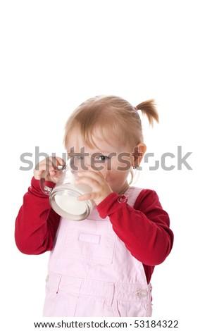 little girl drinks milk - stock photo
