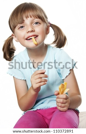 little girl eating a potato chips - french fries - stock photo
