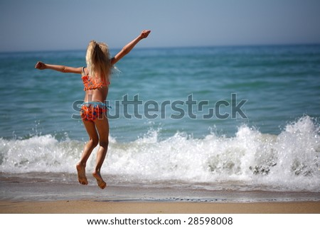little girl  from the sea - stock photo