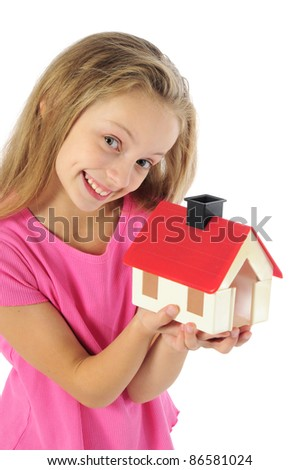 Little girl holding toy house - stock photo