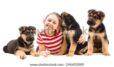 little girl hugging a puppy - stock photo