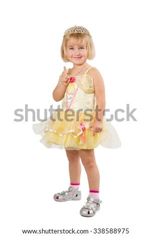 Little girl in a beautiful yellow dress and crown isolated on white background. - stock photo