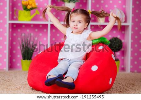 little girl in the nursery. emotions, fun, smile, children's world - stock photo