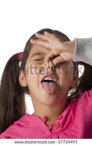 Little girl is closing her nose with her fingers