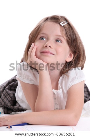 Little girl looking up and thinking - stock photo