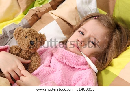 Little girl lying sick in bed - stock photo