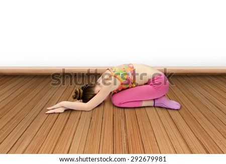 little girl practices yoga indoors - stock photo