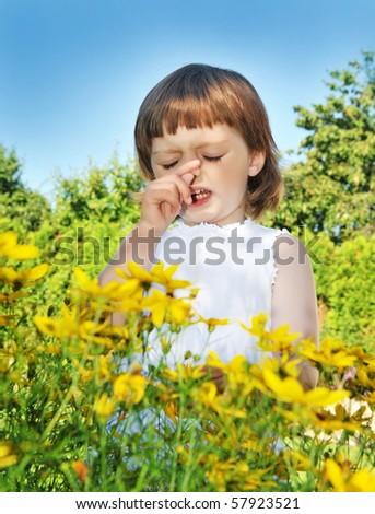 little girl sneezing - pollen fever allergy - stock photo