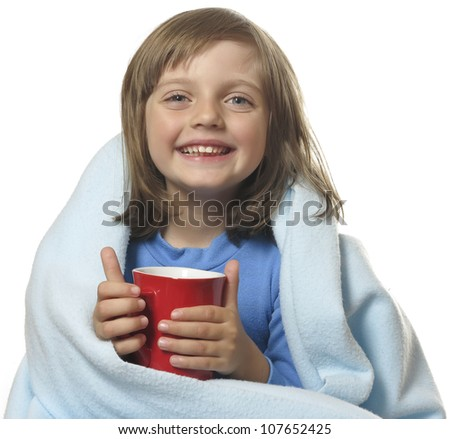little girl with a cup of hot tea - stock photo