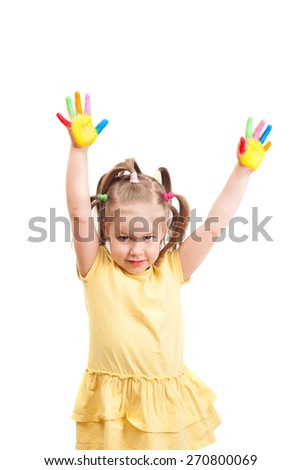 little girl with brightly painted fingers of hands