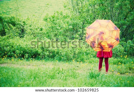 little girl with umbrella outdoor - stock photo