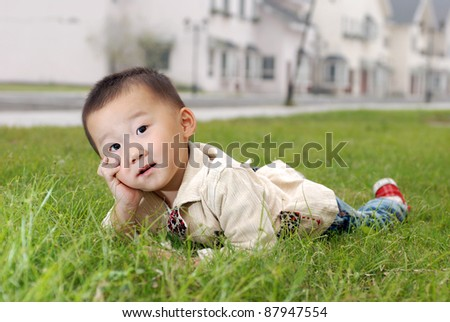 little happy  Asian  boy  outdoor - stock photo