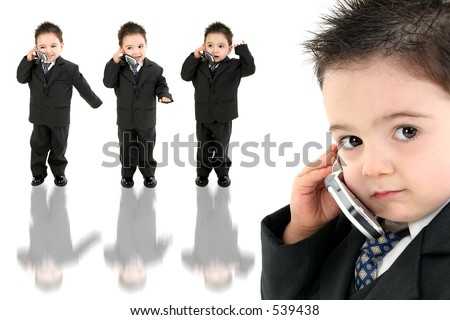 Little man discussing important business on the cell phone. Shot in studio over white. - stock photo