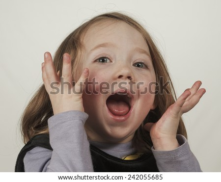 Little school girl screams with excitement  - stock photo