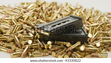 2 loaded magazines and bullets. - stock photo