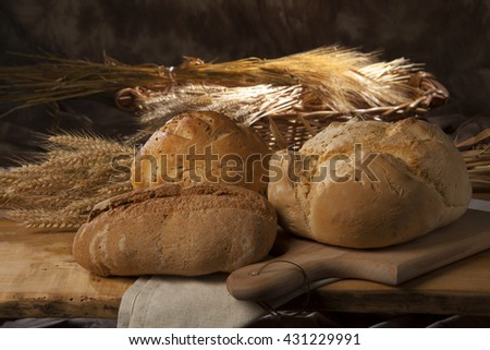 3 loaves of bread, a wheel, a cereal, a white flour
