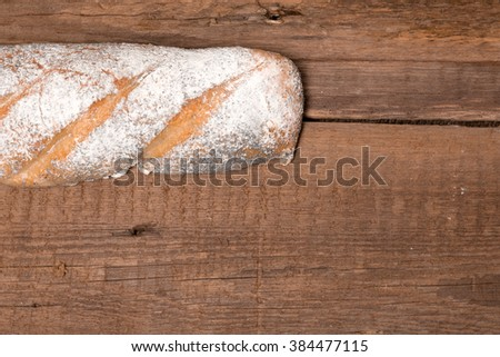 loaves of rye bread on the wooden table