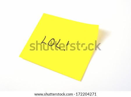 'LOL' written on a yellow sticky note - stock photo