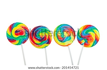 4 lollipops in a row  isolated on white - stock photo