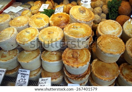 London, England - April 02, 2015: A selection of pies and pastries under the glass display counter of a stall in Borough Market, London.  - stock photo