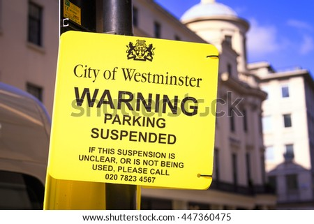 LONDON, ENGLAND JULY 3, 2016: Parking suspended sign in London UK.