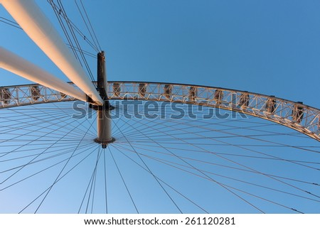 London Eye in Waterloo, London - February 15th of 2015: This is the third largest ferris wheel all around the world. This tourist attraction is 135 meters tall with a diameter of 120 metres. - stock photo