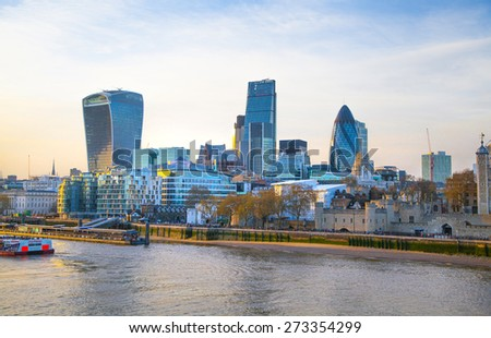 LONDON, UK - APRIL15, 2015: City of London and Tower on the river Thames in sun set light - stock photo