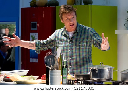 LONDON, UK - DEC 7: Jamie Oliver conducts a cooking demonstration at the Excel center in London, Friday, December 7, 2012 in London, UK - stock photo
