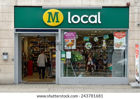 LONDON, UK - JULY 1, 2014: The exterior of a Morroson local supermarket on a street in central London. Morrison is the fourth largest chain of supermarkets in the UK with headquarters in Bradford. - stock photo