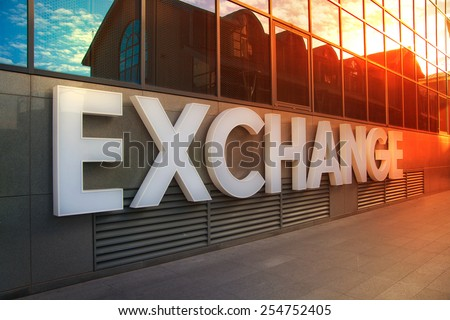 LONDON, UK - NOVEMBER 29, 2014: Exchange sign on the office building in canary Wharf, business and banking aria - stock photo