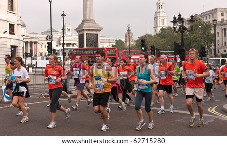 LONDON, UK- OCTOBER 10: Runners in the Royal Parks Foundation Half Marathon, Run Past Trafalgar Square. October 10 2010 in London. - stock photo