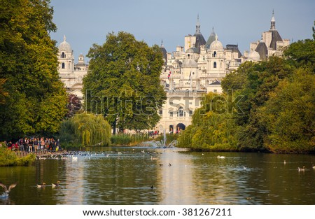 LONDON, UK - OCTOBER 4, 2016: Sant James park, lake and  distant view of Her Majesty's Treasury building - stock photo