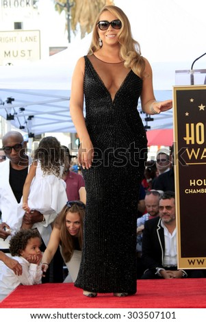, LOS ANGELES - AUG 5:  Roc Cannon, Mariah Carey at the Mariah Carey Hollywood Walk of Fame Ceremony at the W Hollywood on August 5, 2015 in Los Angeles, CA - stock photo