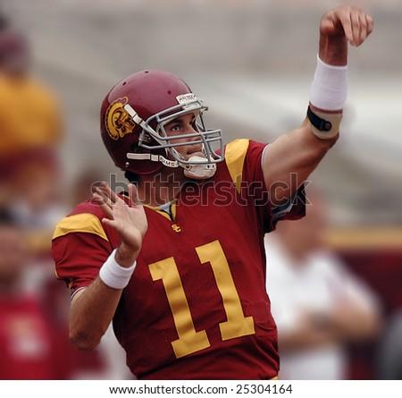 LOS ANGELES – OCT 10: Heisman trophy winning quarterback Matt Leinhart gestures during the game between Usc vs Arizona at the Los Angeles Coliseum on October 10, 2004 in Los Angeles. - stock photo