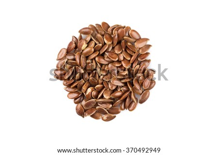 Ð¡lose up of flax seeds isolated on white background - stock photo
