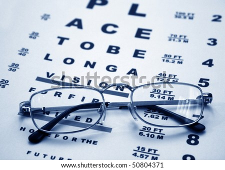 ?lose up of glasses and chart - stock photo