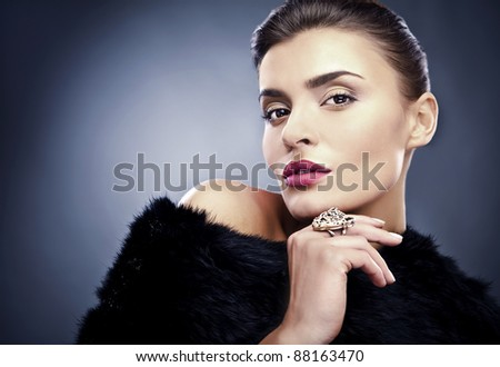 ?lose-up portrait of beautiful woman in fur. - stock photo