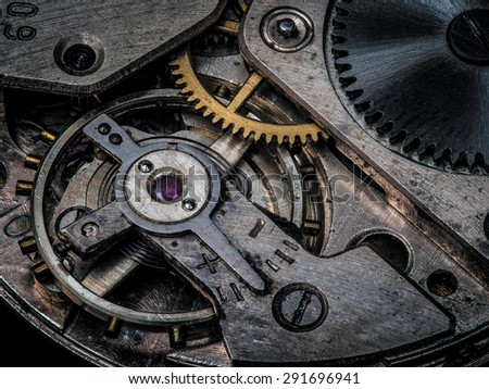 ?lose-up view of the old dirty clockwork - stock photo