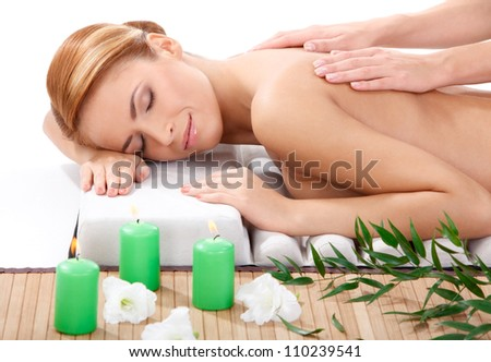 ���±loseup portrait of beautiful young woman getting back massage at spa - stock photo