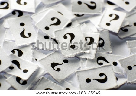 lot of question marks on white papers -hard light - stock photo