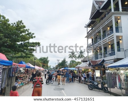 LOUANGPRABANG, LAOS - JULY 12th, 2016 : Daily market daily evening beside a road,This market is selling antiques miscellaneous ,Which is interesting for tourists.