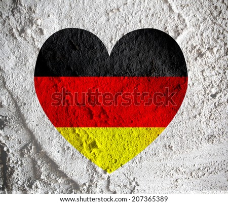 Love Germany flag sign heart symbol on Cement wall texture background design - stock photo