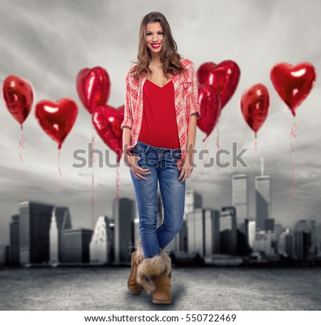 Love girl standing between many red balloons, love is all around us