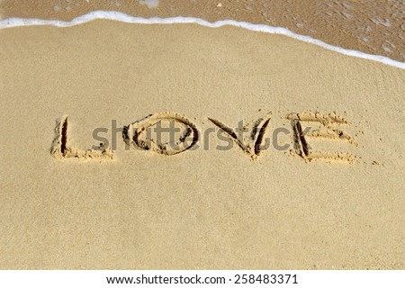 Love  in the sand. - stock photo