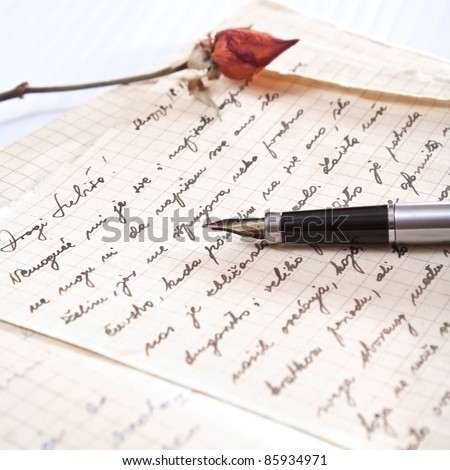 love letter with a rose and pen - stock photo